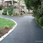 Asphalt driveway with natural stone